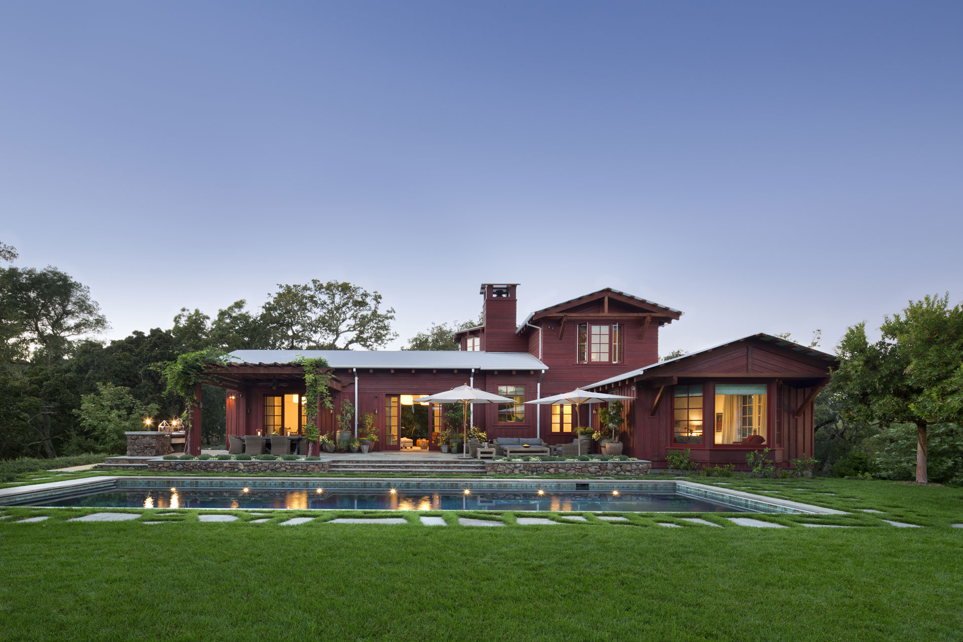 Evening view of the main house across the pool. (Photo credit: Peter Aaron/OTTO for Robert A.M. Stern Architects)
