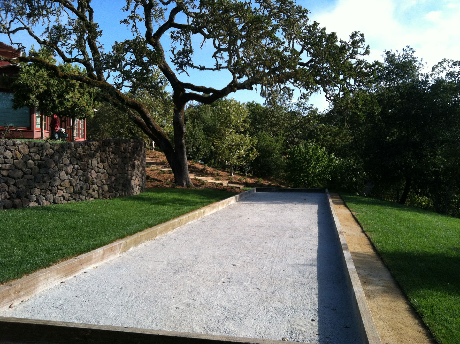 A bocce court was constructed on a terrace one level down from the pool terrace.