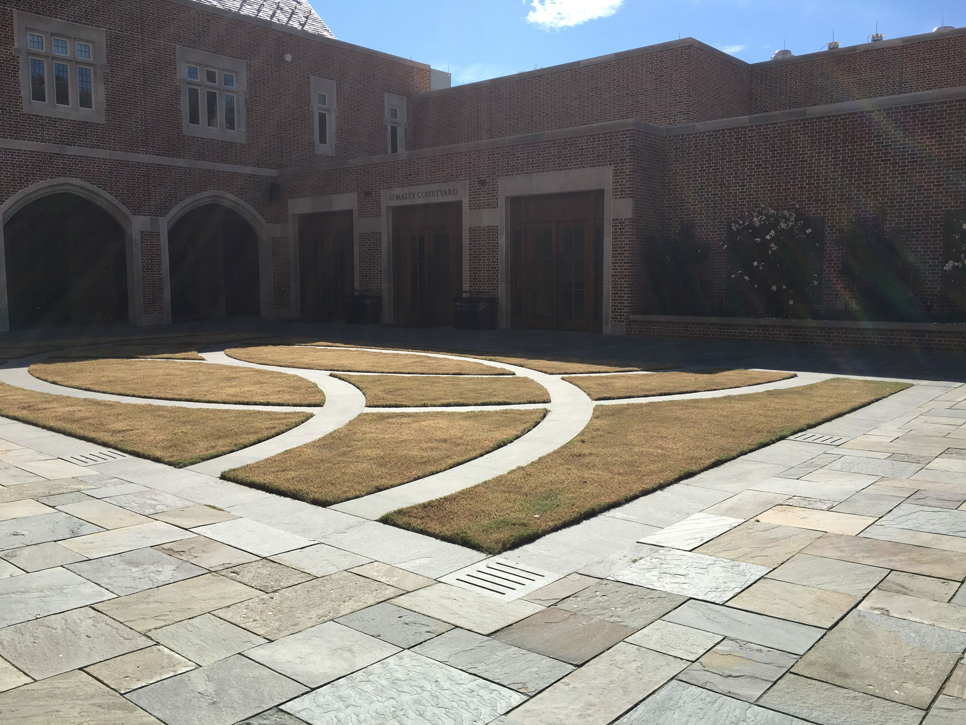 Bermuda Grass browns out seasonally into a color that is beautiful next to the variegated bluestone.
